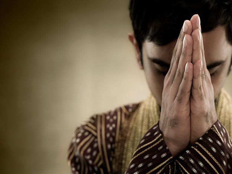 A hindu man praying