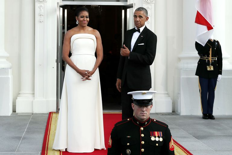 First Lady Michelle Obama and President Obama in formal dress in front of White House