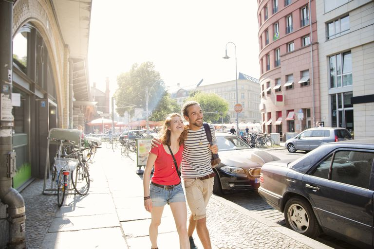 Germany, Berlin, Young couple walking in street