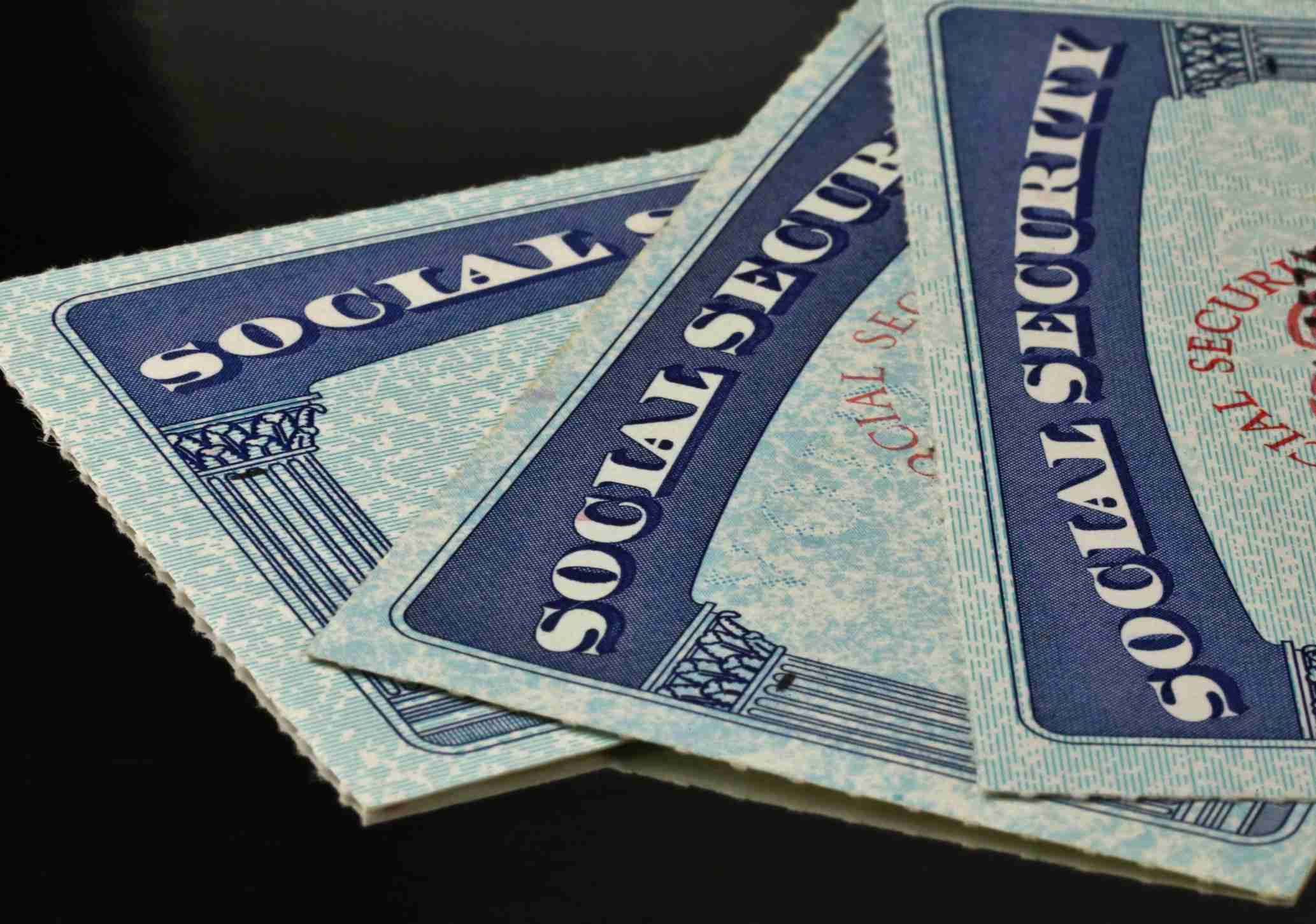 Social Security cards on black background