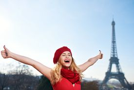 woman gives two thumbs up in Paris