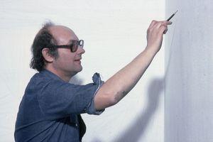 Sol Lewitt creating wall drawing at MOMA (1978)