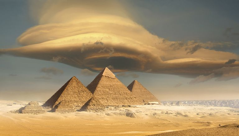 Dramatic storm cloud above pyramids.