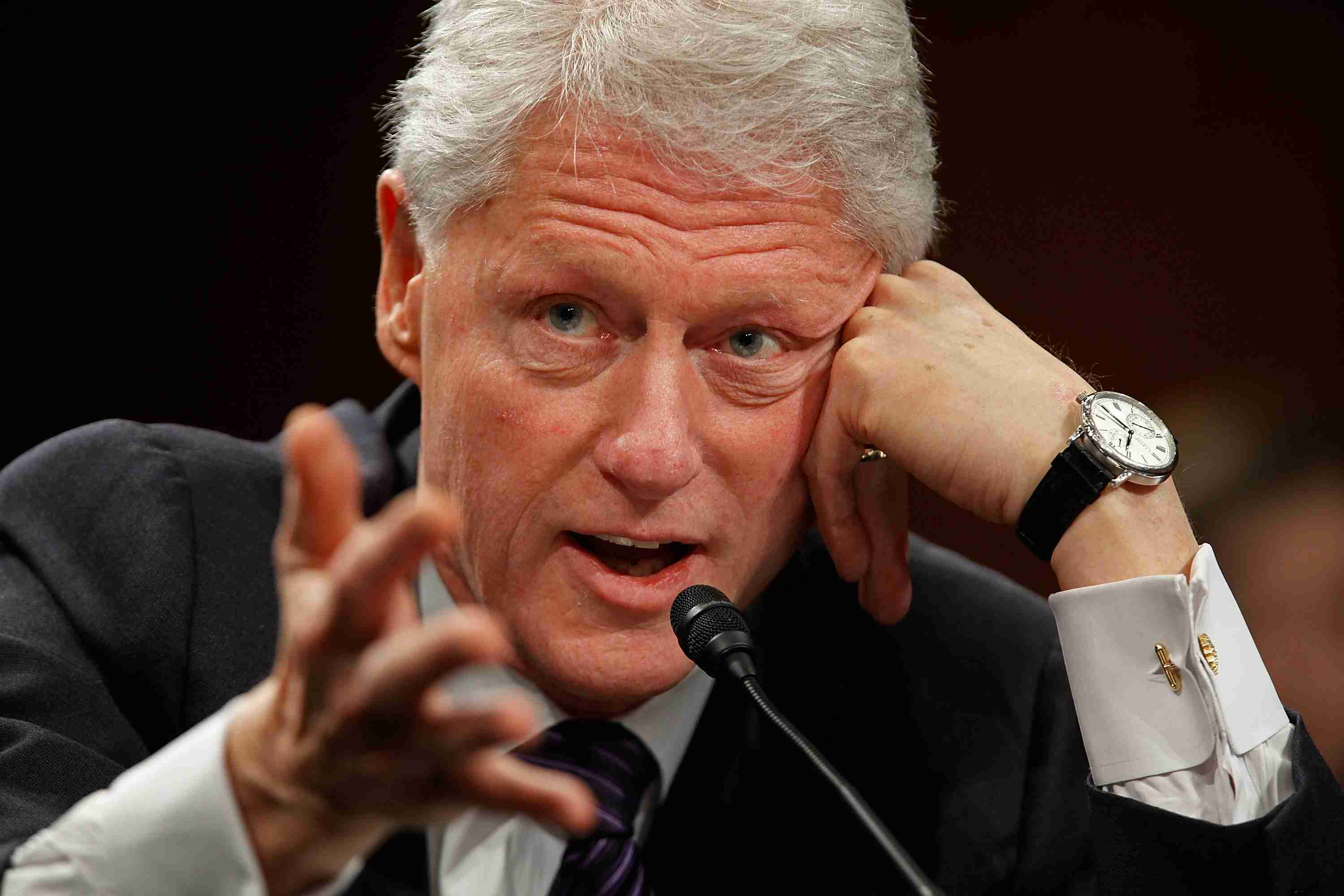 Bill Clinton Speaking into a Microphone