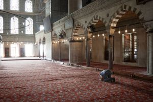 a man praying in the Sultan Ahmed mosque