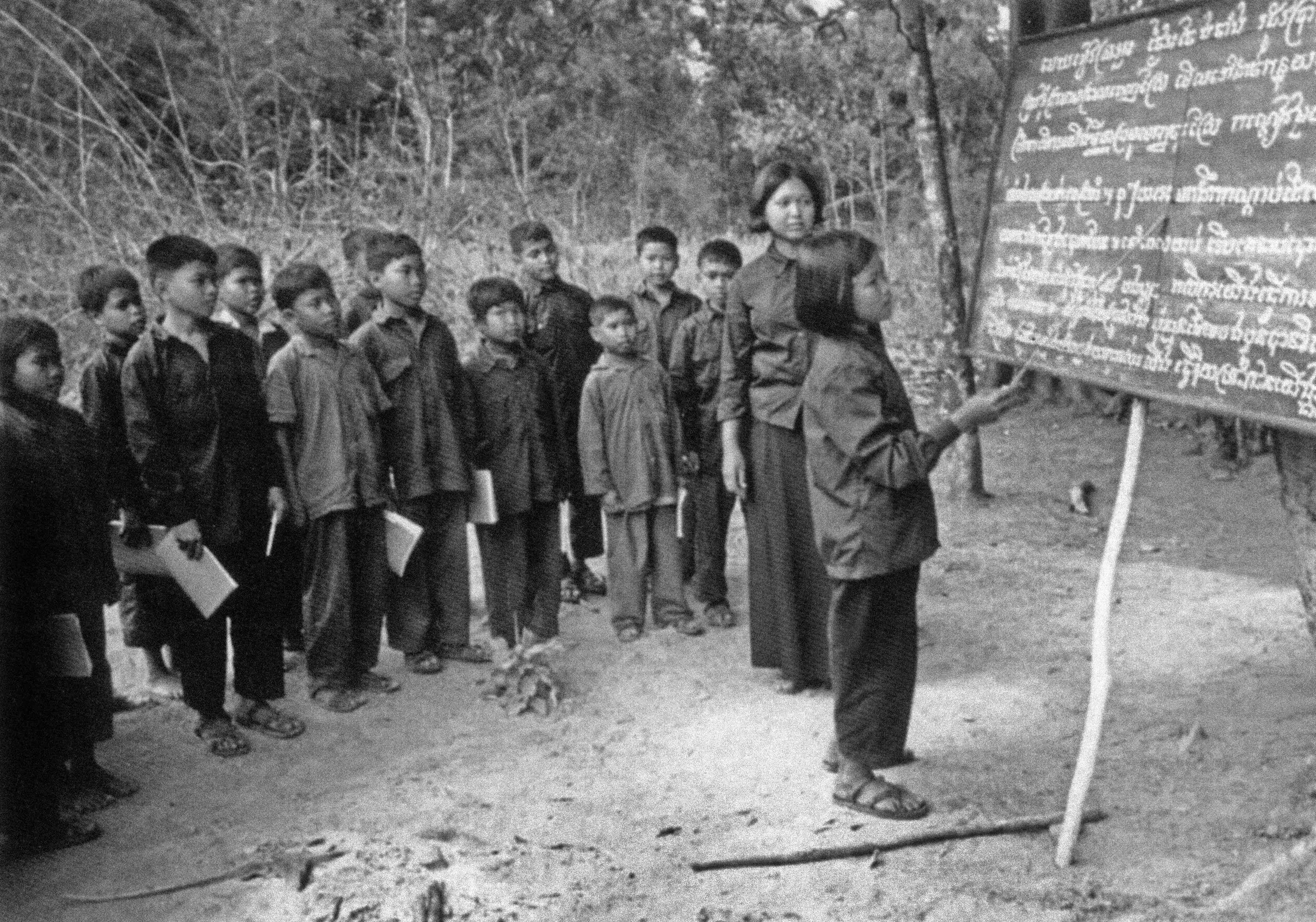 Children learning about harvesting, Cambodia, time of Khmer Rouge, 1975-1979