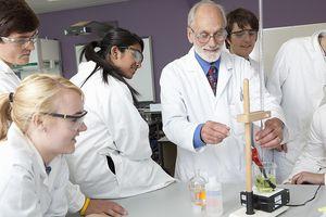 Teacher demonstrating equipment in lab