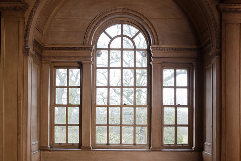 The Three-Part Palladian Window, wooden, 8-paned vertical rectangular windows on either side of a 26-paned arched window