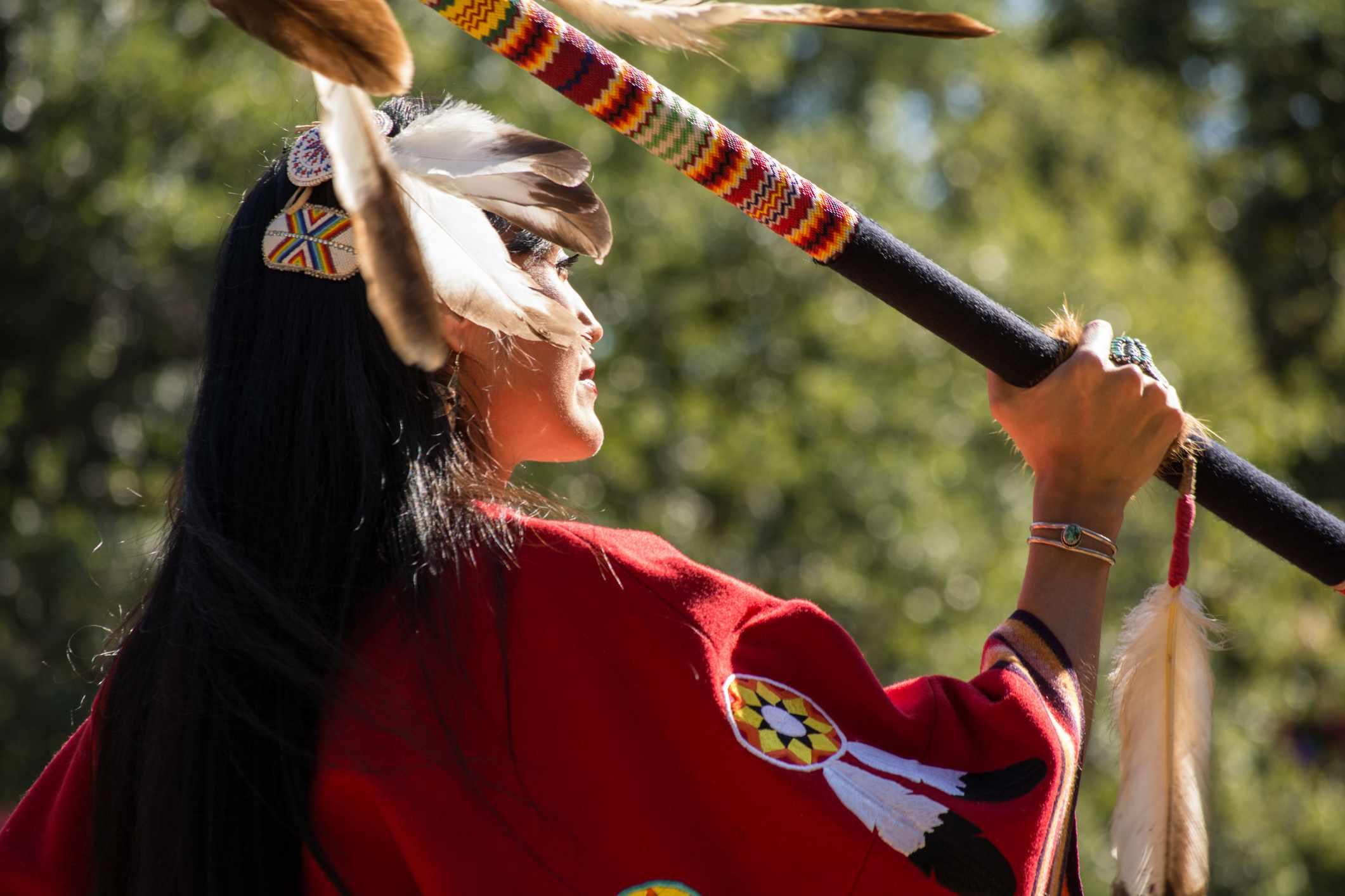Woman dancing at the Kiowa Blackleggings Warrior Society Pow-wow.