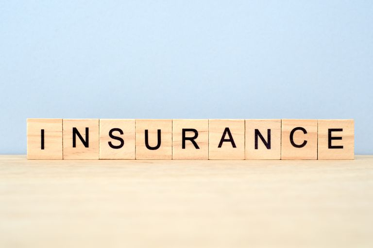 Insurance Word on Wooden Tile Block
