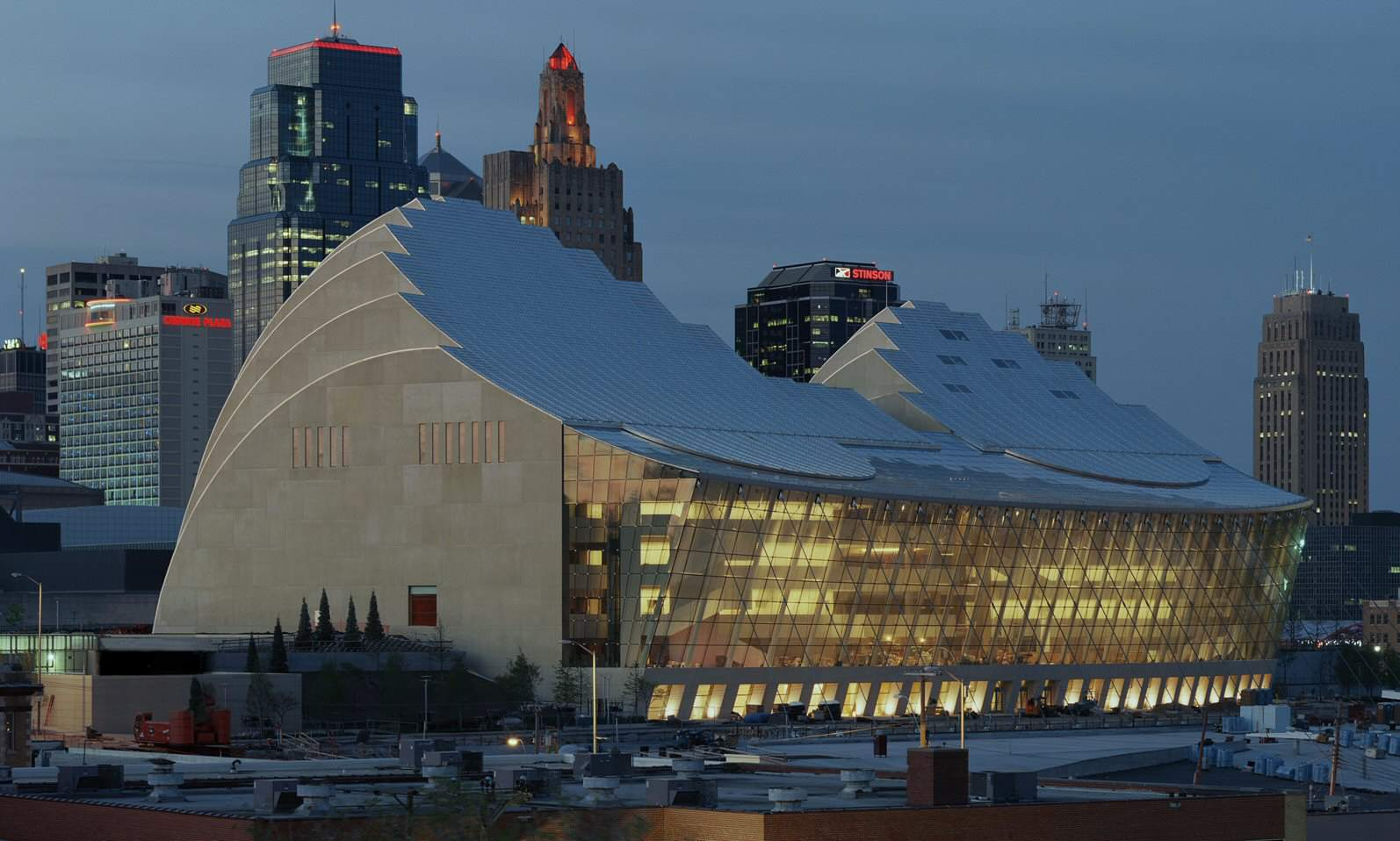 Press photograph of Kauffman Center Hall and Terrace side, in evening, Kansas City in background.