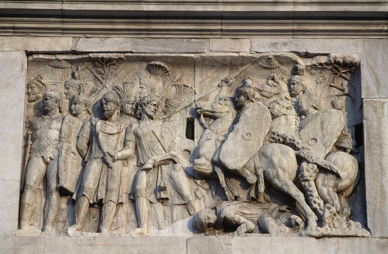 Bas-relief depicting Roman cavalry charge commanded by Emperor Trajan himself against barbarians who are retreating, Arch of Constantine, Rome, Lazio, Italy, Roman civilization