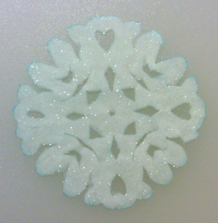 Cover a paper snowflake with crystals to make a glittering crystal snowflake ornament.