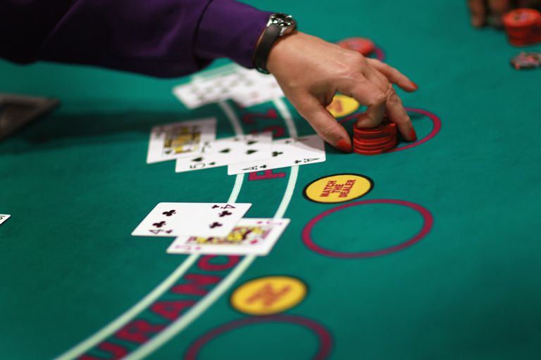 Blackjack table at casino with cards and chips
