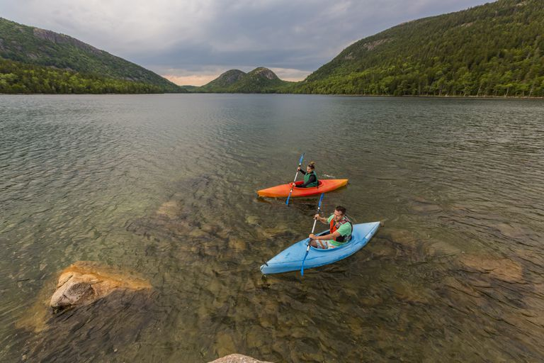 Couple kayaking on Jordan Pond in Acadia National Park, Maine, USA