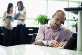 Businessman Using Telephone Headset