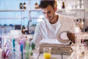 Young scientist reading scientific data in a laboratory.