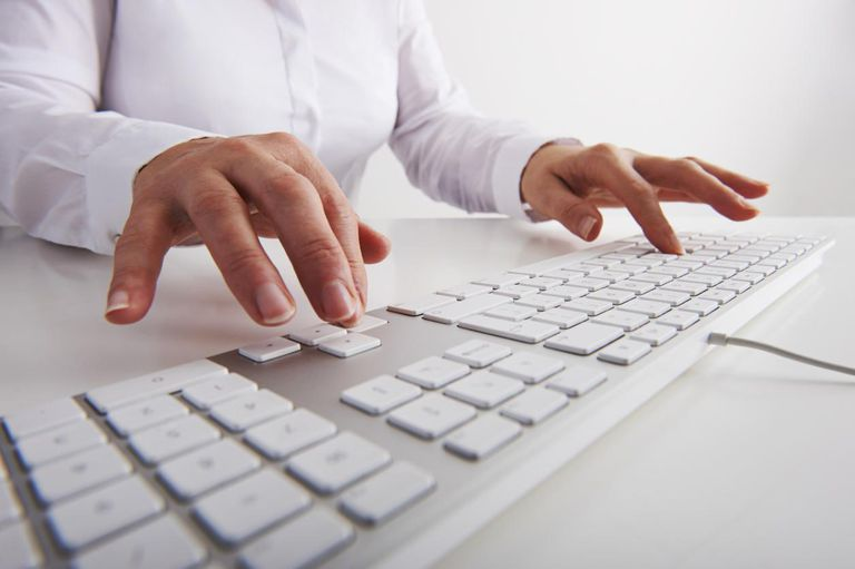 Hands using computer keyboard