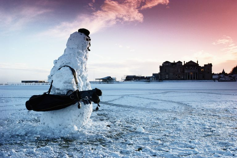 A snowman on the first fairway with the clubhouse in the background at St Andrews Old Course
