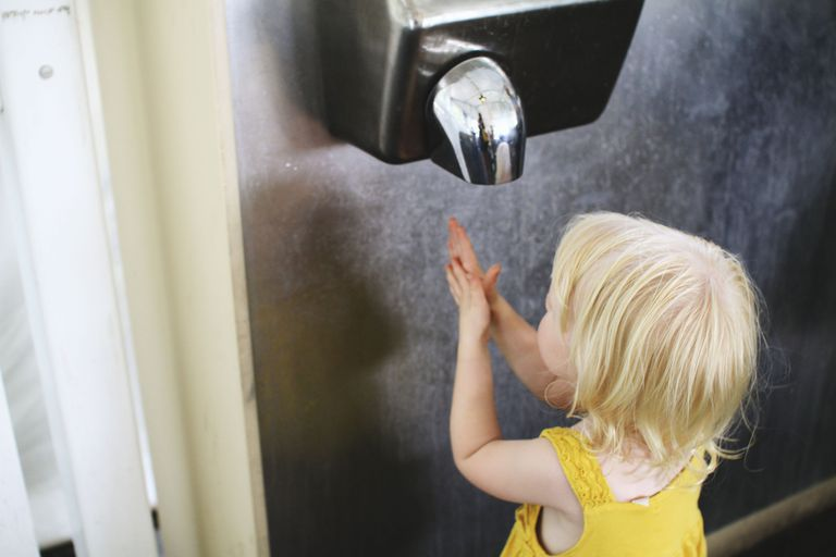 Girl drying hands