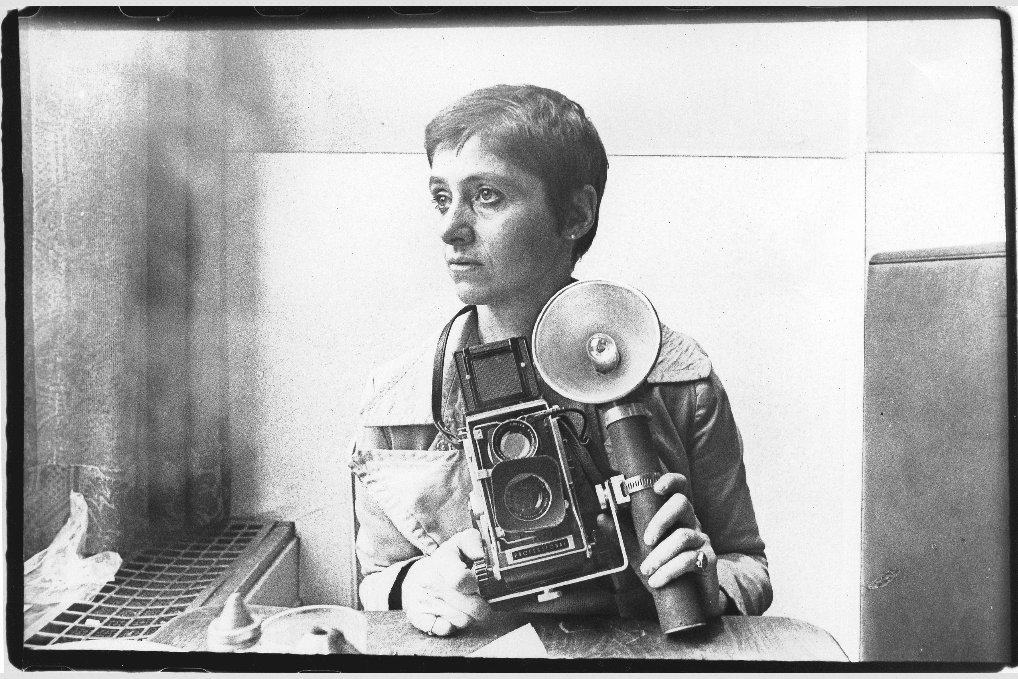 Photographer diane arbus poses for a rare portrait in the automat at sixth avenue between 41st