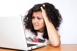 A College Student Working at Her Laptop