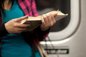 Reading book on subway