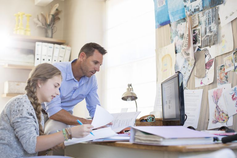 Teen and Dad Studying Together at Home
