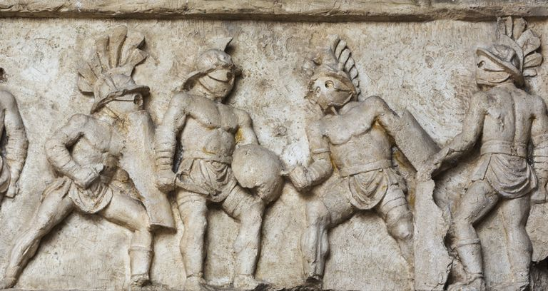 Bas relief in the Roman Colosseum of gladiators fighting