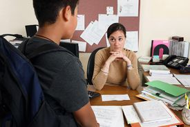 Teacher looks unhappy with student