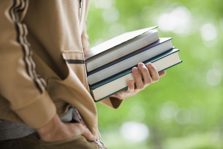 Student Holding Textbooks