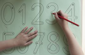 Young student doing math exercises