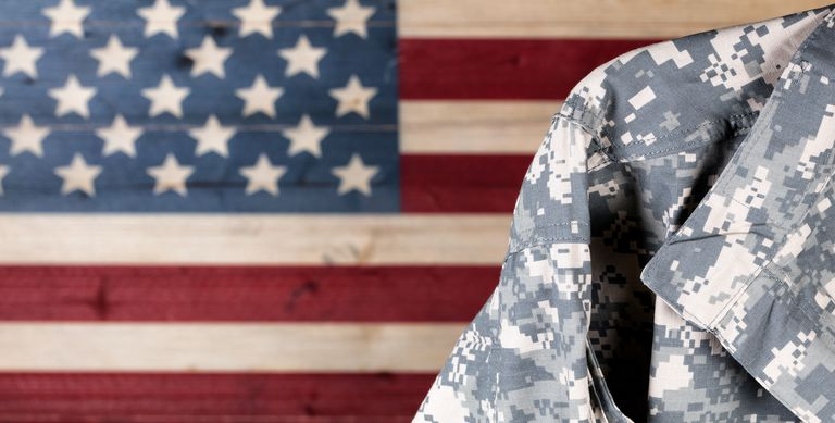 military uniform with american flag in background