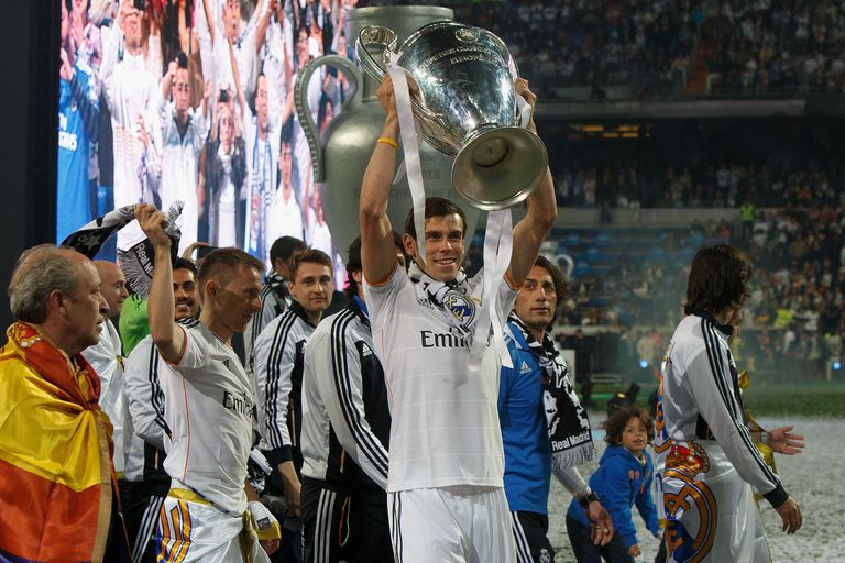 Gareth Bale holds the Champions League trophy aloft