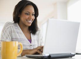 African American woman using laptop