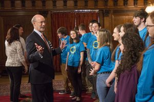 Students at a Montessori school speaking with the state governor.