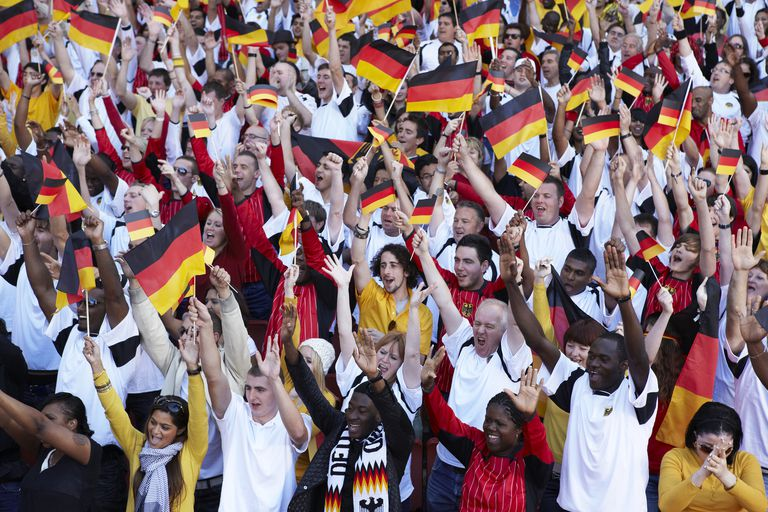 German crowd cheering and waving flags