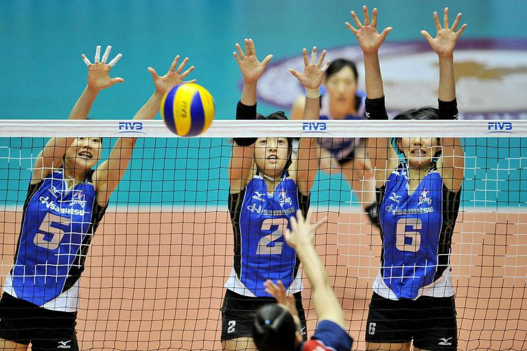 NAKHONPATHOM, THAILAND - APRIL 18: Mizuta Yumi #5, Kotoh Chizura #2 and Ishii Yuki #6 of Hisamitsu block as their competitor spikes during the FIVB 17th Princess Cup Asian Women's Cup Volleyball Championship on April 18, 2014 in Nakhonpathom, Thailand.
