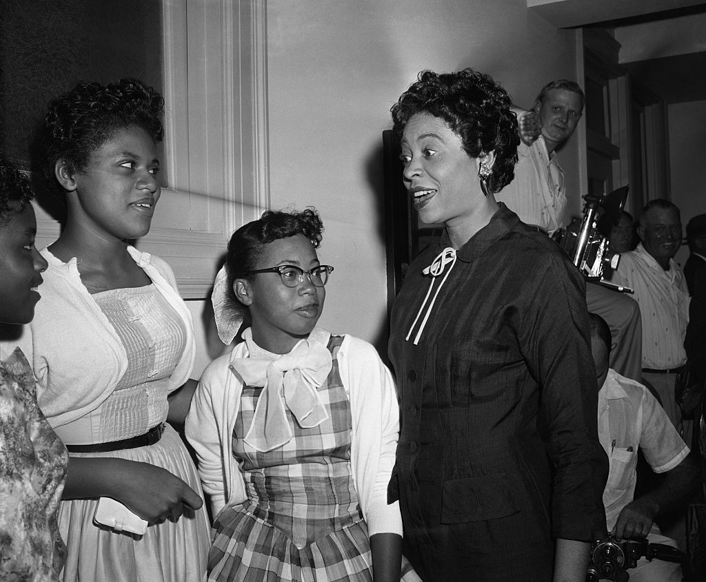 Daisy Lee Bates, president of the Arkansas chapter of the NAACP, with Black students barred from the Little Rock Central High School, 1957.