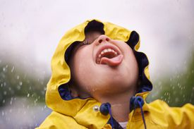 Boy drinking rain water