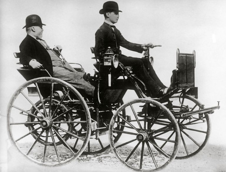 Gottlieb Daimler sitting in a motor vehicle