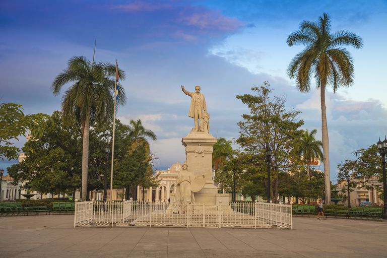 Statue of José Martí in a park at dusk