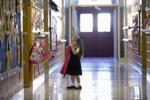 a grammar school hallway with a little girl