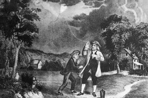 Benjamin Franklin testing his electrical current theory with a kite