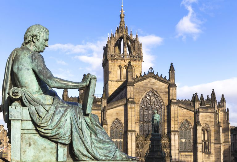 Statue of David Hume in front of cathedral