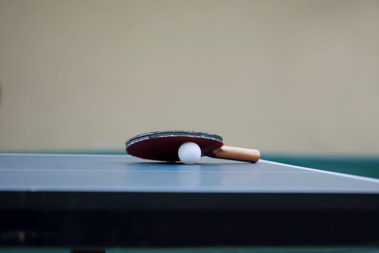 Table Tennis Racket And Ball On