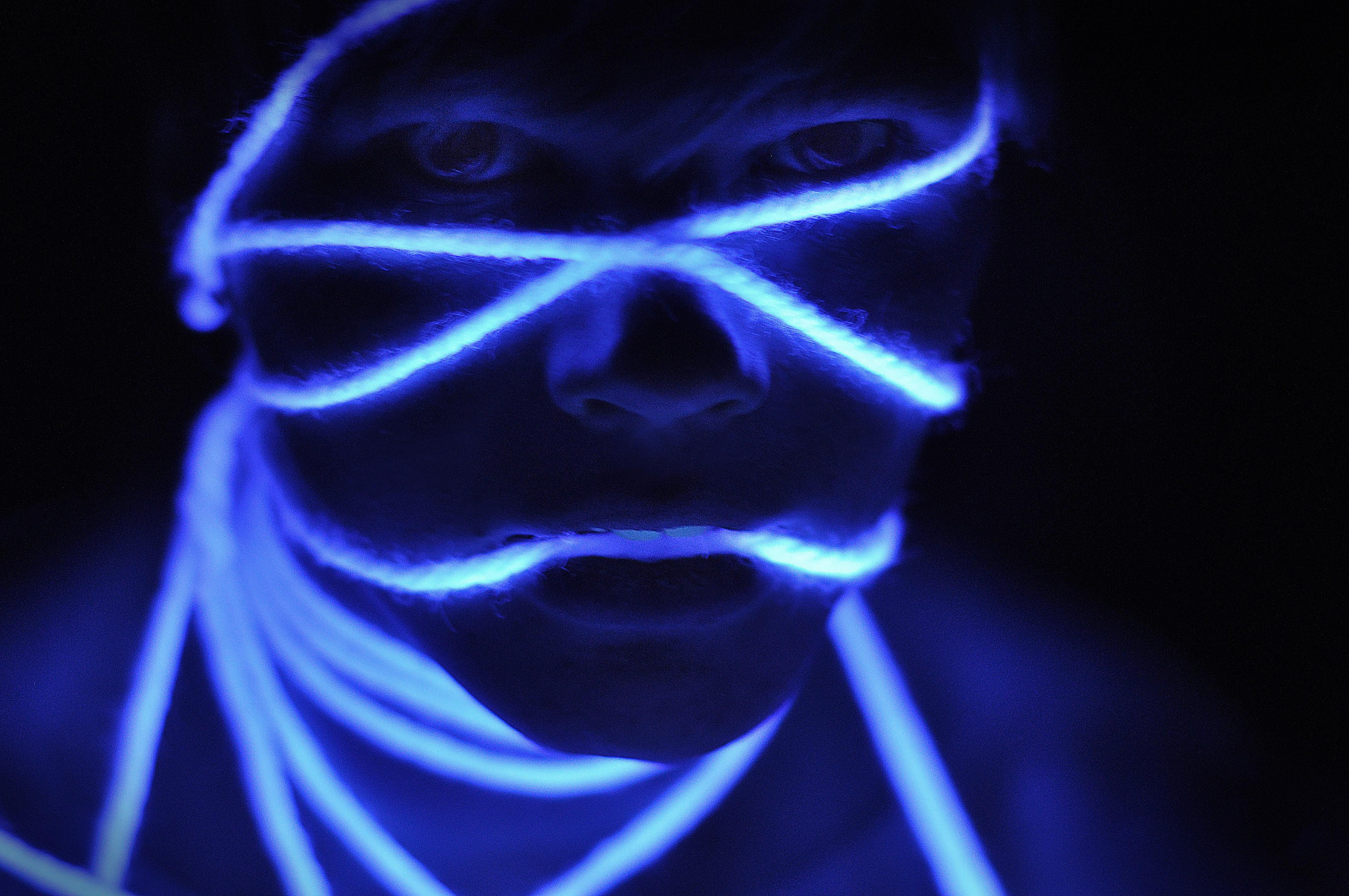 White string and clothes and fishing line all glow under a black light.