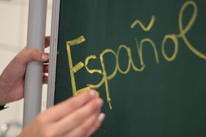 Hand using a chalkboard with