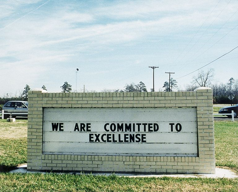 Sign that says we are committed to excellence but excellence is misspelled