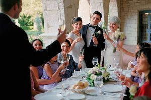 Best man giving bride and groom toast